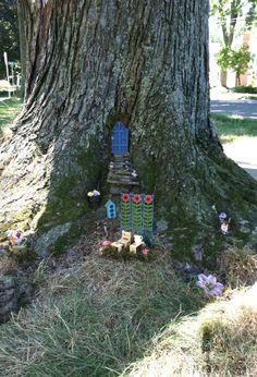 Tree stump fairy garden outside pinterest tree stump for Hallmark fairy door