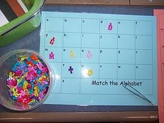 Tweezers, letter mat, and letter beads- great way to use those letter beads I always want to buy!