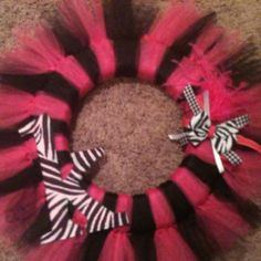 Tutu wreath! I think I will make one for Brystol would look cute in her pink and zebra nursery