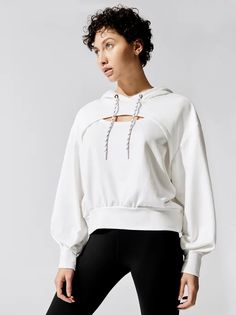 Max out your workout with this essential warm-up layer. The Splice Hoodie from Michi is a cropped pullover sweatshirt with a front cut-out and extra-long cuffs. Balloon sleeves deliver style and dimension to your silhouette. Cut Sweatshirts, Hoodies, Cut Out Hoodie, Lounge Wear, Active Wear, Fashion Outfits, Sporty Fashion, Diy Fashion, Women Wear