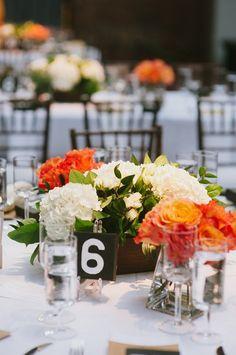 Bright pops of orange! Centerpieces by http://ideas-in-bloom.com! | Photo by http://fatorangecatstudio.com