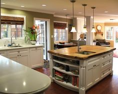 Green kitchen walls with white trim, goes great with tan family room walls.