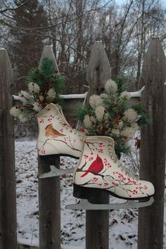 These are some very sweet womens ice skates - each one has a hand painted cardinal (a male and a female) on it, and lots of snow covered berries.