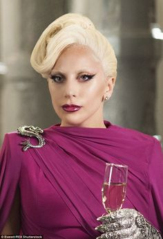 Scary hot:Lady Gaga made waves for her gothic glam look on 'American Horror Story: Hotel' on October 7, rocking an elaborate updo, a bold red lip, and back winged eyeliner