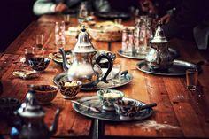 teacups, tea pots, plates on wood table /the a la menthe