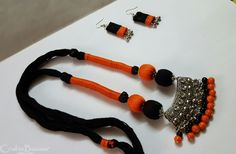 This is a beautiful orange and black tribal necklace with earrings comprised of German silver antique pendant. The neck piece is made using high quality cotton silk threads. It has an adjustable cord. Silk Thread Necklace, Beaded Necklace Patterns, Silk Thread Bangles, Thread Jewellery, Fabric Jewelry, Jewelry Patterns, Beaded Jewelry, Silver Jewelry, Silver Earrings