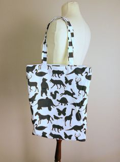 Reversible black and white cotton tote bag With one zipper pocket Usable on both sides Washable One of a kind Ready to ship Handmade Tote