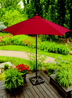 downstairs patio ideas - Use a dramatic red umbrella to create an eye-catching shady spot on your deck or patio