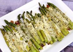 Make the world's best baked asparagus with my easy to follow recipe (so good it's been shared over 267,000 times!). Let me show you step-by-step how to make asparagus your family and friends will love. How to Make Cheesy Baked Asparagus: 1. Line a baking sheet with some tinfoil. Place the asparagus on the baking sheet