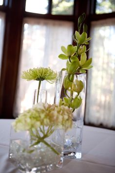 Great idea for floral center pieces! Love it! #Minnesota #weddings #flowers #Minnesotaweddingphotographers www.bellagala.com...