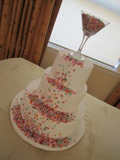 Confetti Cake - I'm not sure who did the original design for this cake, the bride brought me in a photo of what she wanted.  The colours were to match confetti that was on the bride's invitations.  (It took FOREVER to cut the confetti out of fondant)