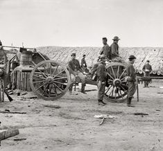 """April 1865. """"Petersburg, Virginia. Federal soldiers removing artillery from Confederate fortifications."""""""
