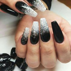 There are three kinds of fake nails which all come from the family of plastics. Acrylic nails are a liquid and powder mix. They are mixed in front of you and then they are brushed onto your nails and shaped. These nails are air dried. Black Ombre Nails, Black Nails With Glitter, Black Coffin Nails, Dark Color Nails, Black Acrylic Nails, Black Wedding Nails, Black Silver Nails, Nail Black, Silver Ombre
