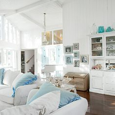 Simple white beach cottage living room.