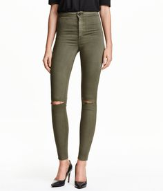 Ankle-length jeans in washed stretch denim with heavily distressed details. High waist and ultra-slim legs.   H&M Denim