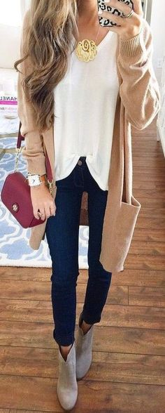 Long camel cardigan,  white top, black skinny jeans, change to black booties, red or burgundy crossbody bag, gold pendant necklace, square watch with camel leather band
