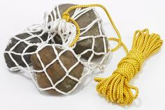 Use a basketball net and rope, fill with rock for a portable anchor...