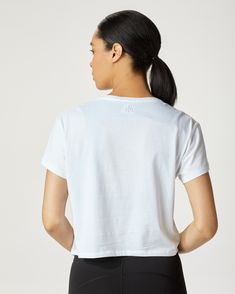 The perfect relaxed, boxy tee with an embossed MICHI logo. Layer over your sports bra and pair with MICHI leggings or wear it with high waisted denim. Also available in:Black. Tie Shorts, Waisted Denim, Trendy Outfits, Leggings, Bra, Logo, Sports, Logos, Fashionable Outfits