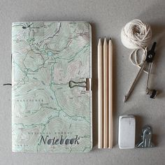 map notebook, string, pencils