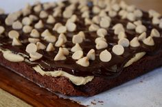 This recipe for peanut butter cookie dough brownies is addicting and amazing and delicious. For cookie dough lovers only. Yummy Treats, Delicious Desserts, Dessert Recipes, Yummy Food, Dessert Food, Cookie Dough Brownies, Peanut Butter Cookie Recipe, Brownie Bar, Dessert For Dinner