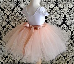 Vintage pink 8 super fluffy sewn tutu with ribboned waist. First tutu, flower girls or a special birthday.. $88,00, via Etsy.
