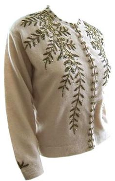 This angora sweater made by Peacock Sweaters in the early 1960s has a '50s feel to it thanks to the beaded-vine pattern and beaded sewn-closed buttonholes.
