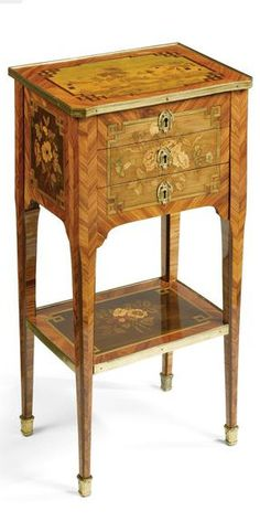A Louis XVI ormolu-mounted tulipwood and floral marquetry table en chiffonnière circa 1780 the rectangular top with an ormolu gallery above three drawers, the uppermost fitted for writing, raised on square tapered legs joined by a platform stretcher; the top veneered with a panel of landscape marquetry, the front and sides inlaid to form floral bouquets.