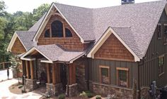 """I like the vertical board & batten and stonework...not sure I love the """"shaker shingles"""" at the top??"""