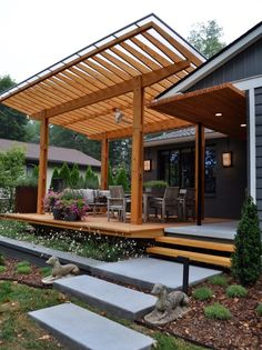 Concrete free floating steps lead to this beautiful cypress outside cantilevered deck. This pavilion has a clear polycarbonate roof, antiques, teak furniture and steel planters. What a wonderful party pergola!