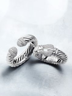Bold sterling silver bracelets with diamonds.