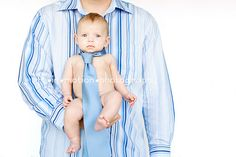 Baby wearing tie, which is for father