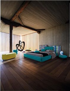 Rustic Modern Aqua Bedroom Concept  Love the upholstered aqua/teal bed and the huge floor pillows.