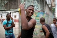 A teenager jokes with friends as he leaves an open air sports center in downtown Havana, January 20, 2015. REUTERS/Alexandre Meneghini