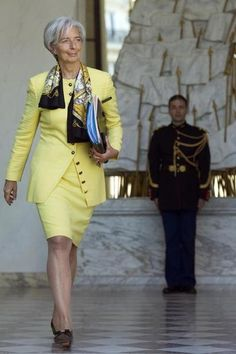 Leaving a Cabinet Meeting in Yellow Chanel