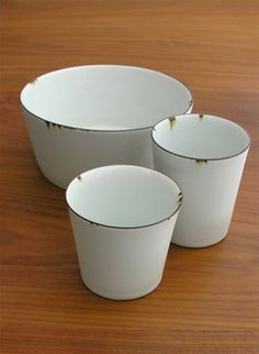early 20th centuries. Influenced by the ageing process of the enamelware, Coelho adds an iron oxide edge to the reduction-fired porcelain glazed in a pale celadon. The results are sturdier than they look. Coelho's goal is to produce simple forms that are glazed with subtlety, and here the iron oxide adds an element that seals the deal.