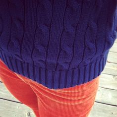 deep purple cable sweater and red orange cords