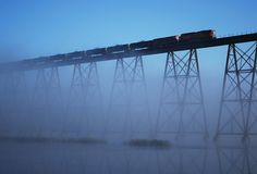 A BNSF freight train heads into the fog at Luverne, North Dakota; by revbry, via Flickr