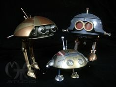 """The """"Fix-Its"""" which are living machines from 1987's movie Batteries Not Included. Pictured are; Carmen, Kilowatt, and baby Wheem."""