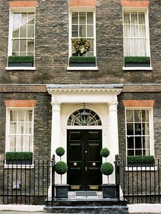 I want the greenery window boxes for our windows! Lovely London Apartment
