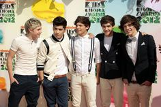"""FILE - In this March 31, 2012 file photo, One Direction, from left, Niall Horan, Zayn Malik, Louis Tomlinson, Liam Payne, and Harry Styles arrive at Nickelodeon's 25th Annual Kids' Choice Awards in Los Angeles. On Nov. 13, 2012, One Direction released its sophomore album, """"Take Me Home,"""" which comes eight months after the boy band dropped its debut, """"Up All Night,"""" which debuted at No. 1 and is platinum. (AP Photo/Chris Pizzello File)"""