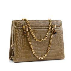 A Gucci tan crocodile handbag