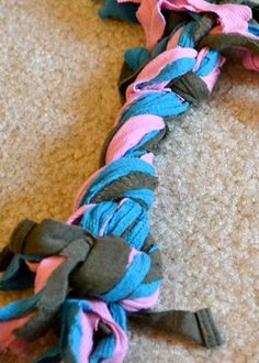 DIY T-shirt dog toy - maybe I can make a couple for when the boys have to stay at Pet Camp