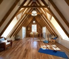 Traditional Conversion - Exposed beams against white walls and beautiful wood flooring - steep pitch roof