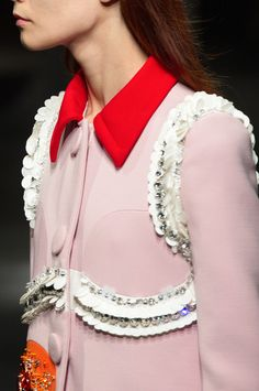 "A breath of ""Don't BossaNova Me Around"" pink, punctuated with pops of color and textured lines. #PradaSS14"