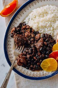 Feijoada - Brazil's National Dish - The Woks of Life Brazilian Dishes, Brazilian Recipes, Brazilian Black Beans Recipe, Pork Recipes, Cooking Recipes, Pulses Recipes, Rice Recipes, Cooking Tips, Recipies