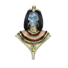 "Theo Fennell Cleopatra brooch The Cleopatra-inspired piece, designed in an homage to the great Queen, is hand-crafted and comprises emeralds, rubies and diamonds with the Queen's skull portrait carved in moonstone and her hair in black spinel. The Scarab is carved from tektite, which is believed to be created from meteorites that broke up in the atmosphere resulting in the molten glass. The ancient Egyptians called the stones ""the tears of the gods"" and only the Pharaoh was allowed to wear…"