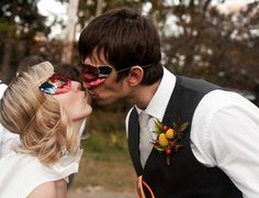 a Vintage Superhero themed wedding. The Bride and Groom wore capes and masks.