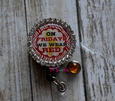 Check out this item in my Etsy shop https://www.etsy.com/listing/222495313/on-fridays-we-wear-red-retractable-id