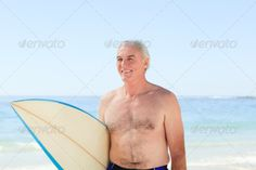 Retired  man with his surfboard ...  active, adult, background, beach, beautiful, beauty, board, coast, day, elderly, happy, hobby, holding, holiday, hot, lady, life, lifestyle, male, mature, men, model, old, oldest, one, people, person, portrait, retired, senior, smile, sport, summer, surf, surfboard, surfer, vacation, water