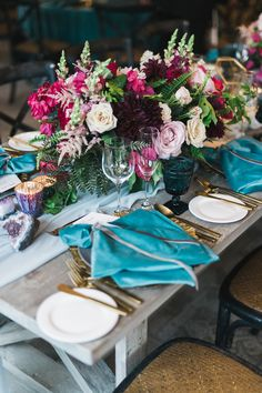 The jewel-toned garden roses and dahlias in this Little Hill Floral Designs arrangement played nicely with the turquoise napkins on this reception table, which had a gem-inspired vibe from start to finish.
